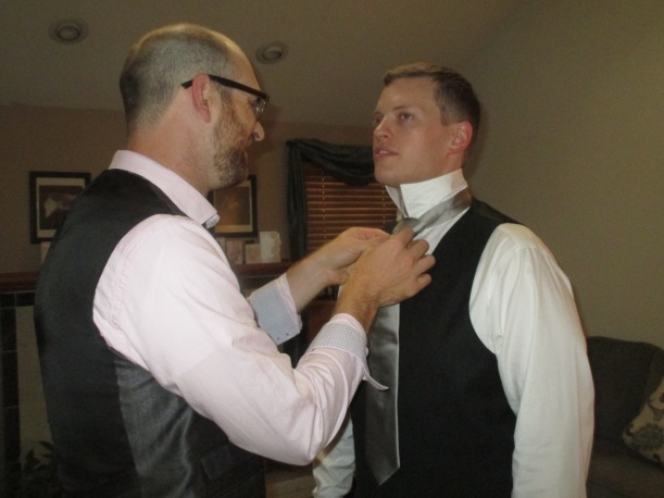 Getting ready, Nick fixing Jerry's tie. Superman cufflinks, a gift from the bride, already on.